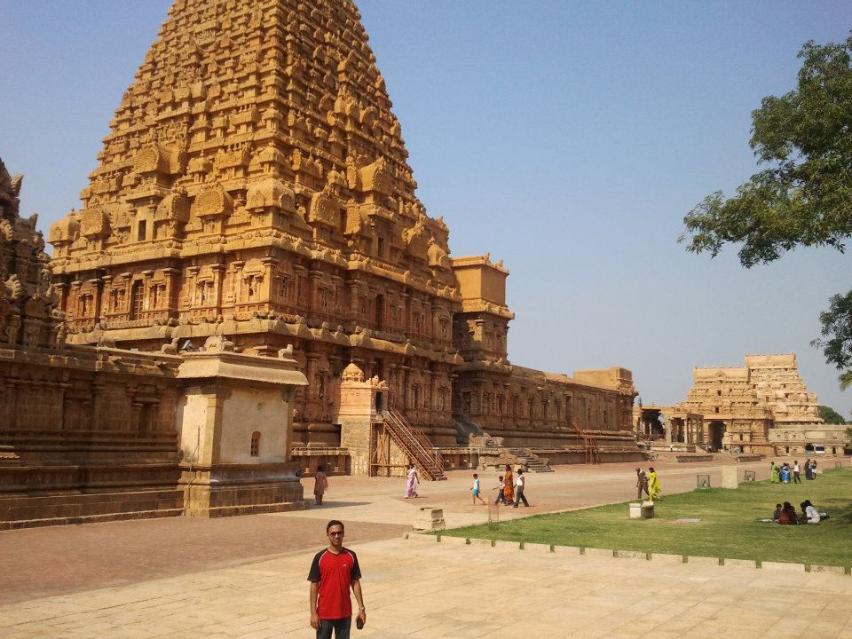 Me looking tiny in front of the Brihadeeswara Temple tower, Thanjavur.