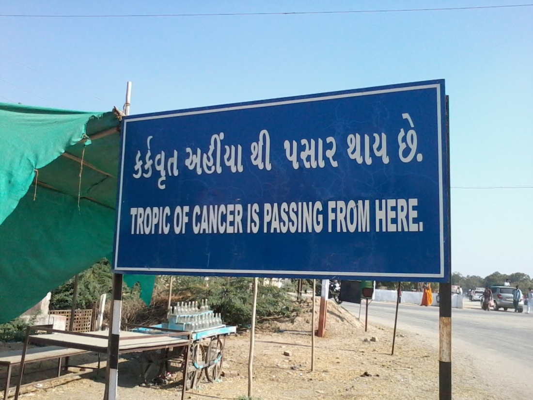 The board indicating the passage of the Tropic of Cancer on the outskirts of Becharaji, Gujarat.