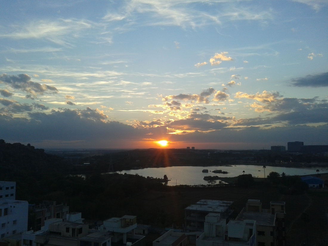 Sunset over Khajaguda lake, Hyderabad.I clicked it from a friend's flat near ORR.