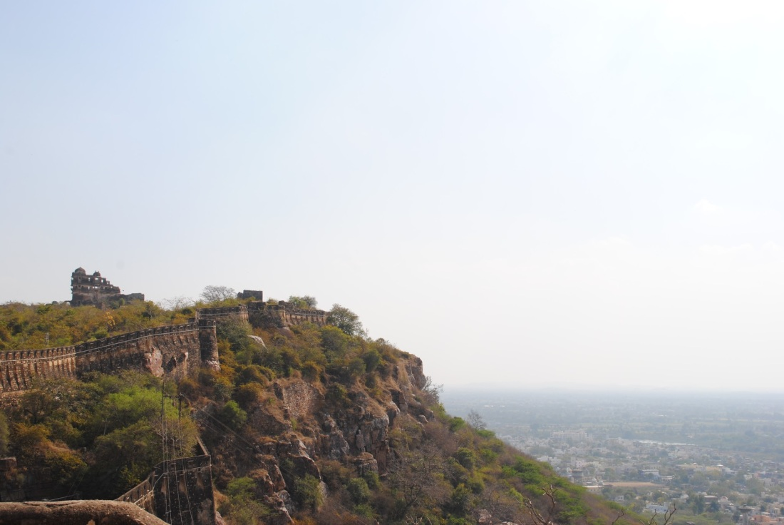 Walls of the fort with a view of the town below, Chittorgarh.