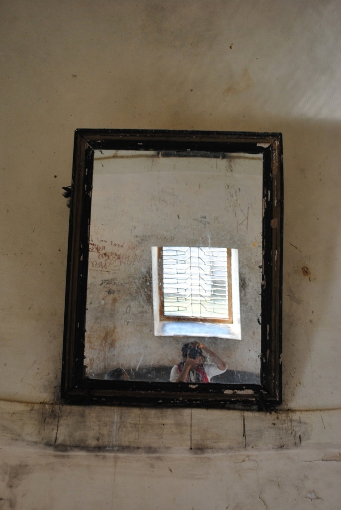 One of the mirrors in the fort hall, Rani Padmini's palace.