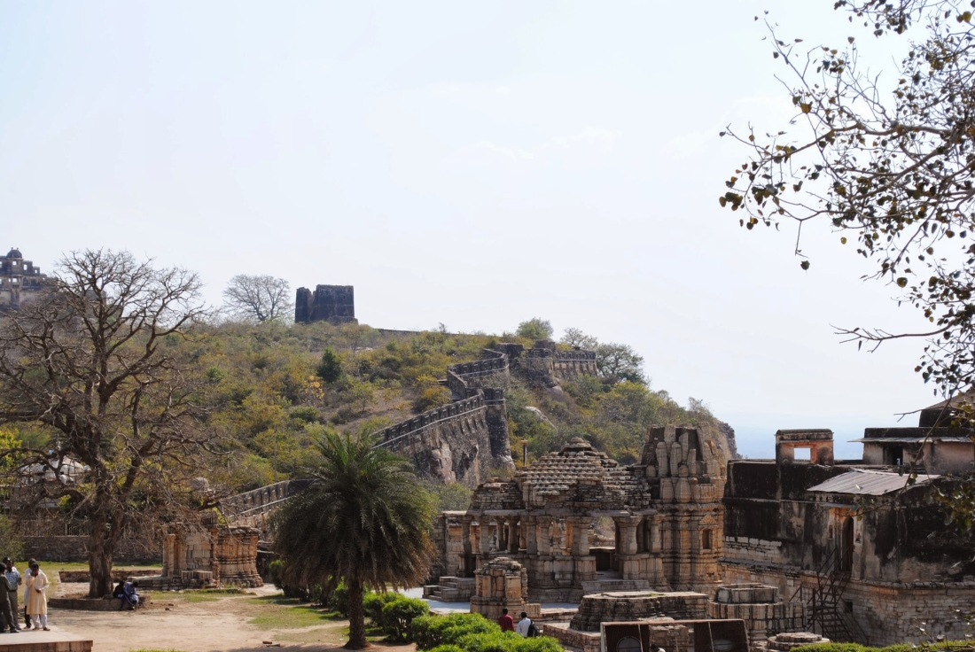 Temple ruins with the fort walls in the background.