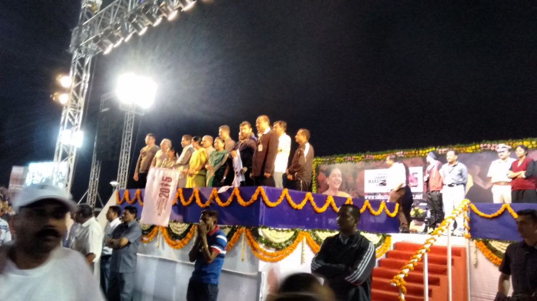 Anandiben Patel (in green sari) flags us off.