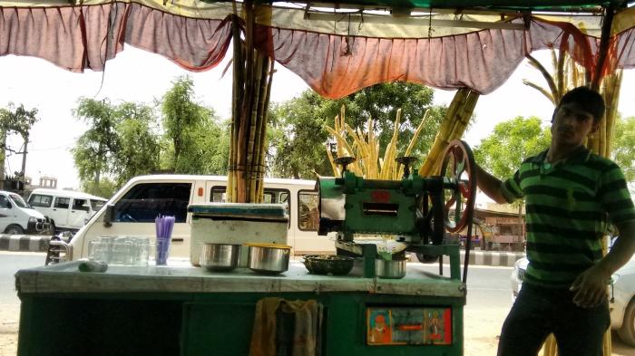 Sugarcane juice break at Mehsana outskirts.